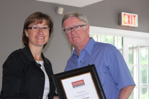 Greg Evans accepting his award from Chrisandra Firth