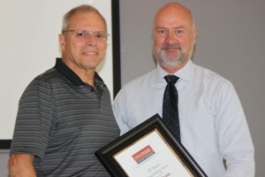 Ron Crane accepting his award from Paul Peterson